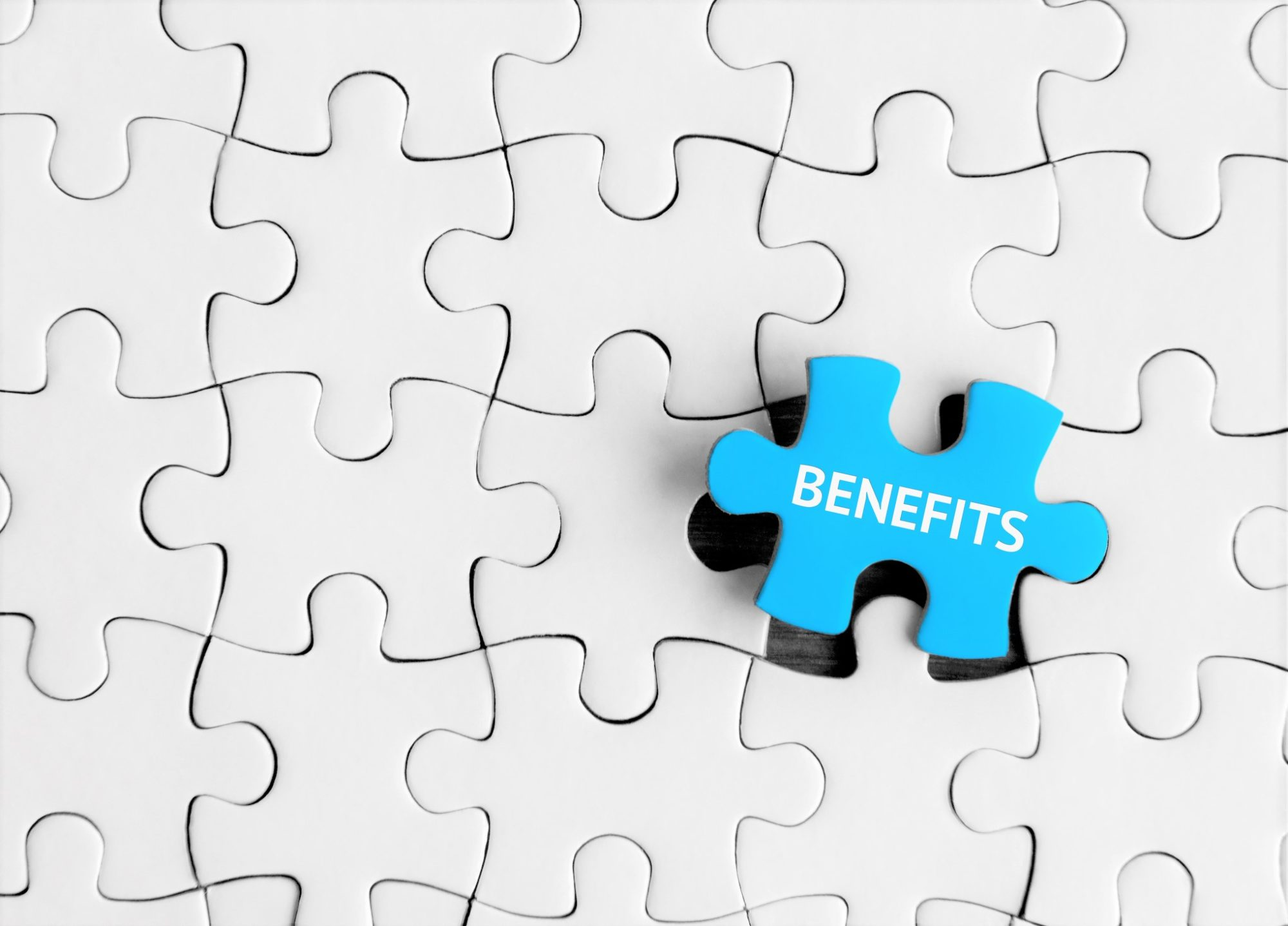 Puzzle pieces with word 'Benefits'
