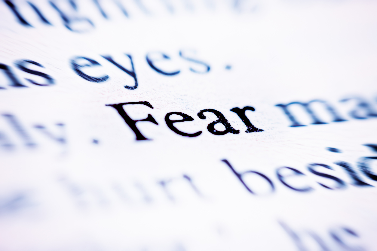 """The word """"Fear"""" stands out on a printed page otherwise defocused."""
